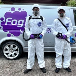 Two Fog workers pictured in front of a Fog van